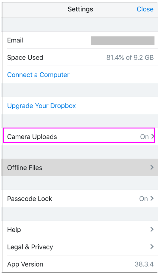 How to disable automatic photo upload feature in Dropbox on